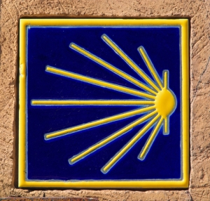 Stylized scallop shell markers mark the Camino for pilgrims.Photo by Lianem
