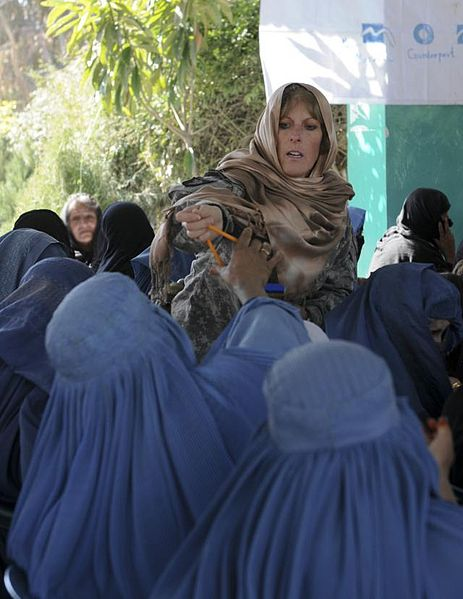Lt. Col. Pam Moody with Afghan women, March 8, 2011Photo by Spc Tobey White