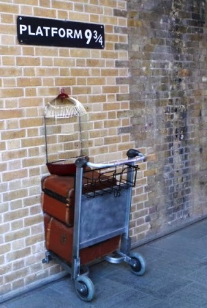 Platform 9 3/4 has been moved to several different locations in Kings Cross station. In each location, it has been a popular photo stop.