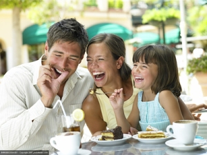 Laughing family eating