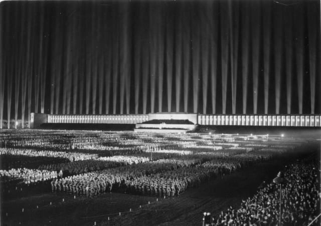 "Rallies such as this ""Light Cathedral"" in 1936 fed the fascination. Only the central reviewing stand remains now. Photo from Wikipedia"