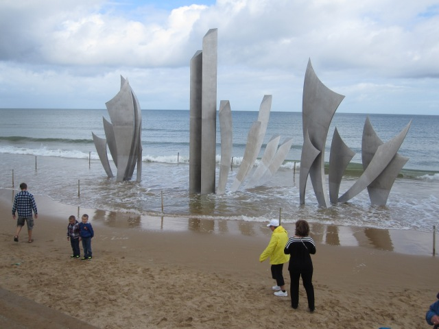 "This memorial entitled ""Les Braves"" marks the section of coast called Omaha Beach. Photo by J. Emmons"