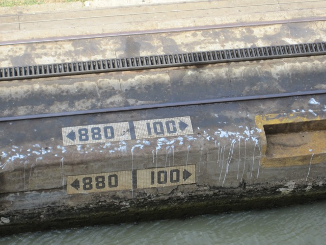 The Portland cement sidewalls show some aging. Numbers tell how many yards to the lock gates in each direction. Cogs of the engines' railway are visible above.  Photo by J. Emmons
