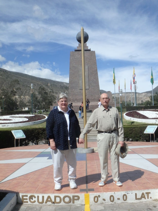 Here we are to the north and south of the Equator with the monument behind us. Photo by Henry