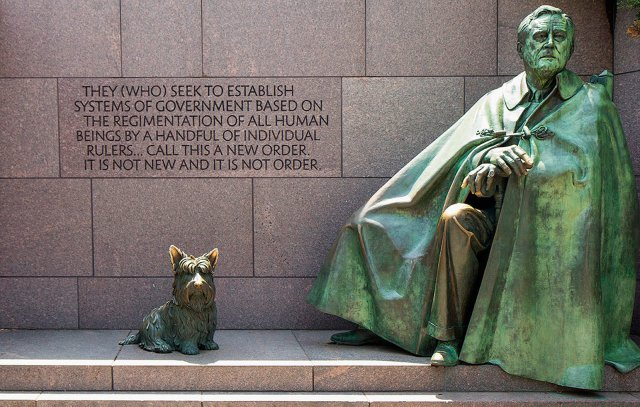 The larger statue of FDR includes his dog Fala but no chair is visible.