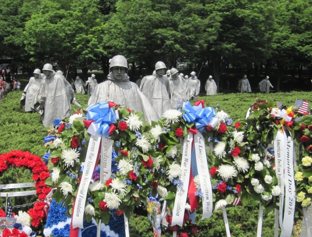 Memorial Day wreaths at the front of the formation. Photo by J. Emmons