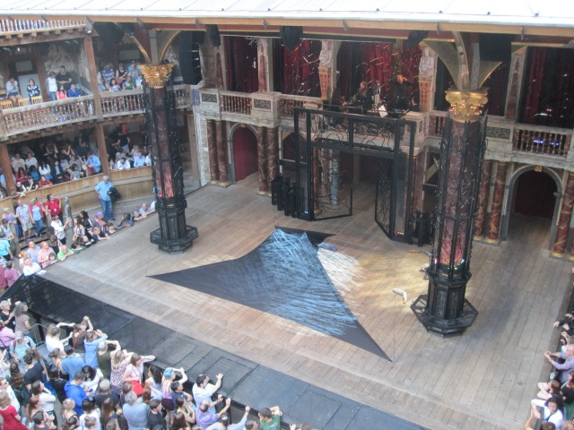 The stretchy black fabric was used in the first scene and later with Banquo's ghost. The metal stage extension and grating around the pillars also aided special effects.