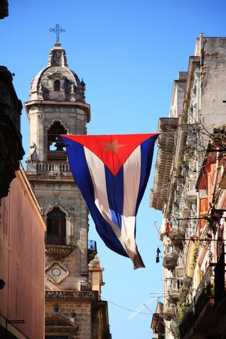 Cuban flag near the capitol in Havana Photo by Deborah Benbrook | Dreamstime.com